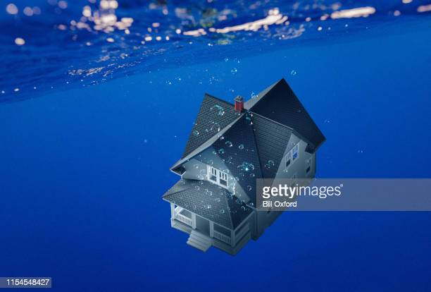 house underwater: home mortgage concept of lost value - bailout stock pictures, royalty-free photos & images
