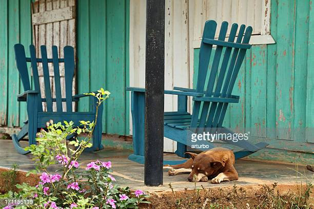 house veranda with dog and rocking chairs in Cuba