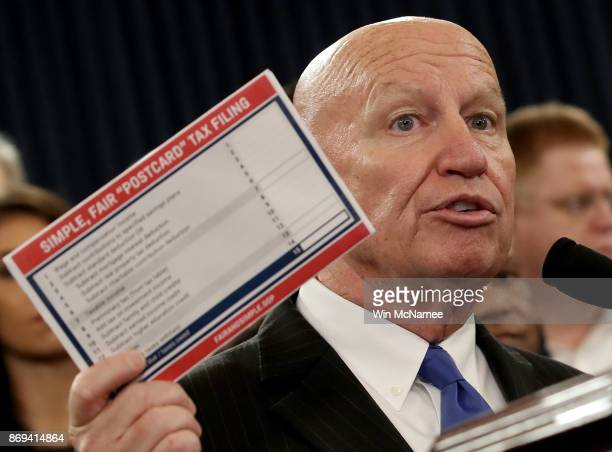 House Way and Means Chairman Kevin Brady joined by members of the House Republican leadership introduce tax reform legislation November 2 2017 in...