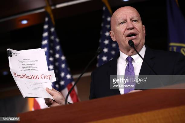 House Ways and Means Chairman Kevin Brady holds a copy of the newly written American Health Care Act while answering questions during a news...