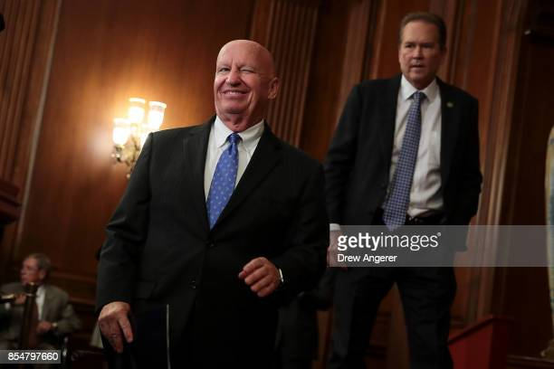 House Ways and Means Committee chairman Kevin Brady winks as he arrives for a press event to discuss their plans for tax reform September 27 2017 in...