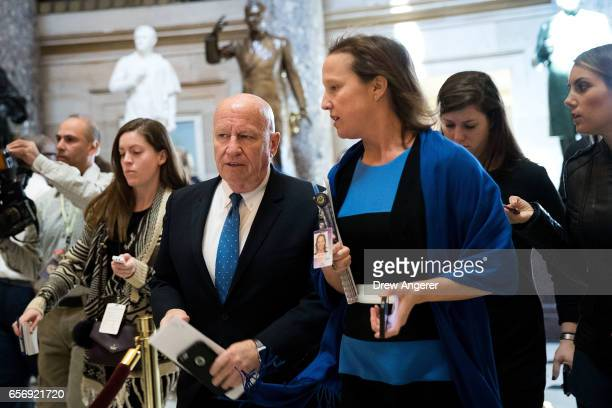 House Ways and Means Committee Chairman Rep Kevin Brady walks with an aide through Statuary Hall on Capitol Hill March 23 2017 in Washington House...