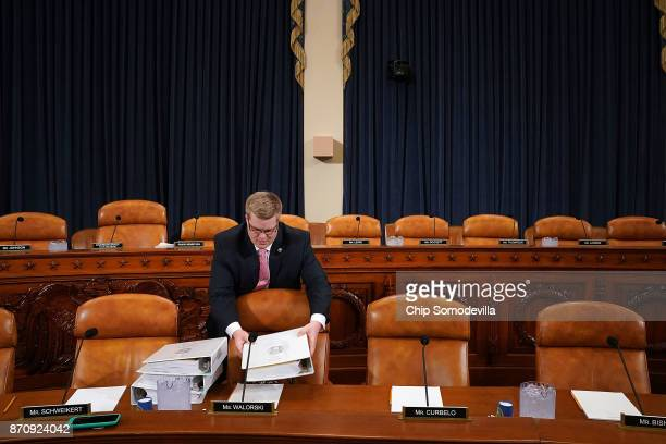 House Ways and Means Committee majority staff member Thomas Kutz delivers copies of the proposed GOP tax reform legislation before a markup session...