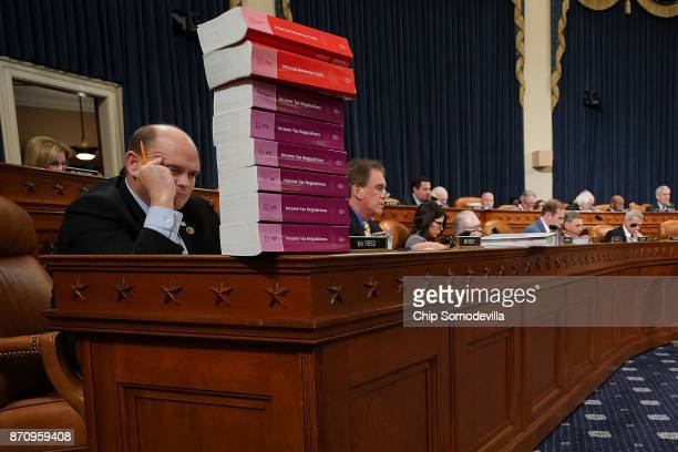 House Ways and Means Committee member Rep Tom Reed keeps a stack of books that document the current federal tax code and related regulations on his...