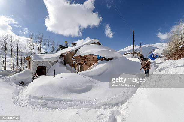 A house which is covered with snow because of a night long heavy snowfall is seen in the Gorentas neighborhood of Catak District in Van Turkey on...