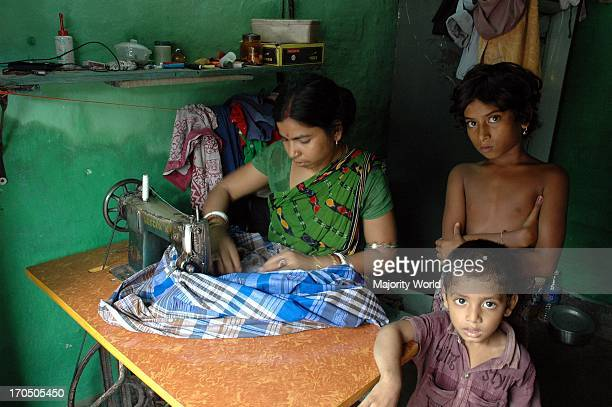 A house wife sewing a lungi at a Road side slum of Kolkata city Most of the transient roadside settlements and slums have been formed by refugees...