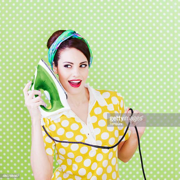 House wife using an iron as a phone, humor.