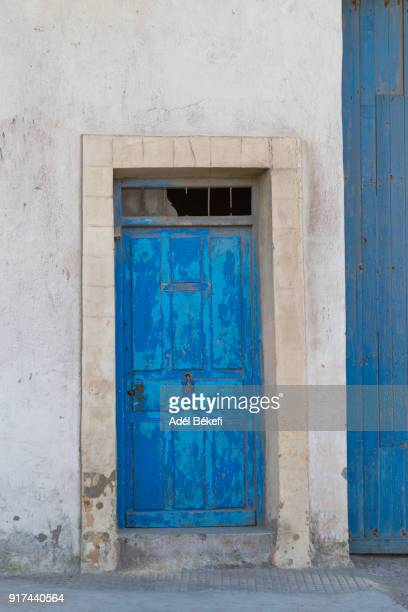 A house with blue old door in the street (Morocco, Marrakesh)