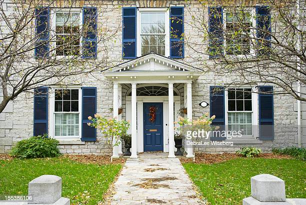 house with blue shutters - kingston ontario stock photos and pictures