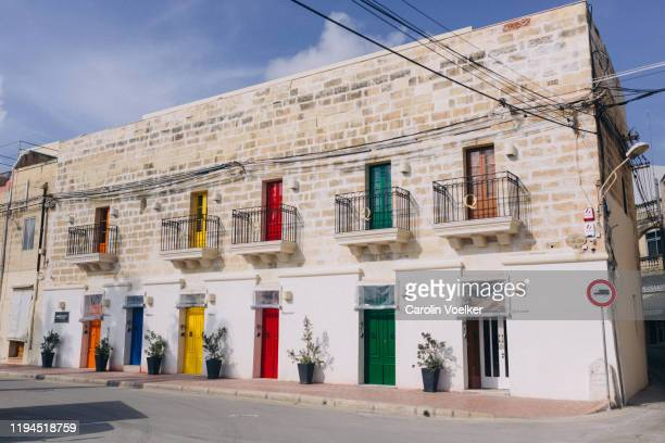 house with colourful doors and window panes in marsaxlokk, malta - marsaxlokk stock pictures, royalty-free photos & images