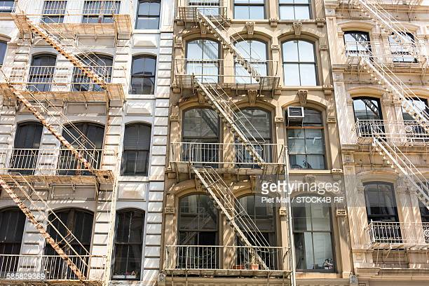 house with fire escapes, soho, new york city, new york, usa - soho new york stock photos and pictures