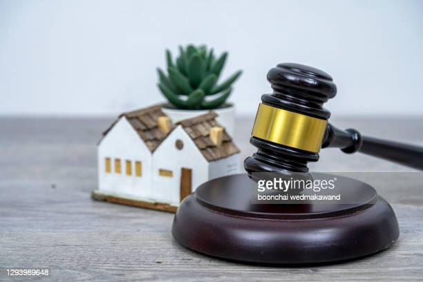 house with gavel. real estate law and house auction concept. - auction stock pictures, royalty-free photos & images