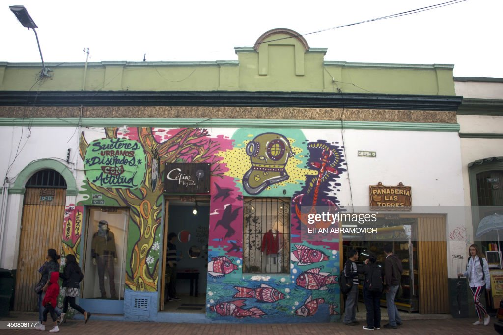 A house with graffiti in Bogota on November 19, 2013. The graffiti, once considered vandalism, is gaining more space in Bogota, with a city tour and the support of the mayor's office which provides walls, materials and fees to street artists. AFP PHOTO/Eitan Abramovich /