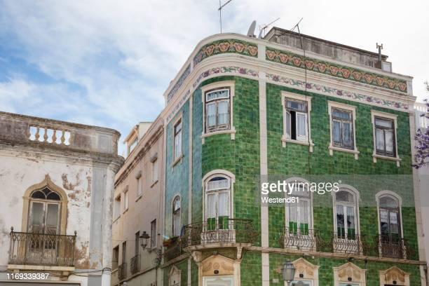 house with green ceramic tiles, lagos, algarve, portugal - faro district portugal stock pictures, royalty-free photos & images