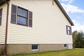 House with pale yellow vinyl siding