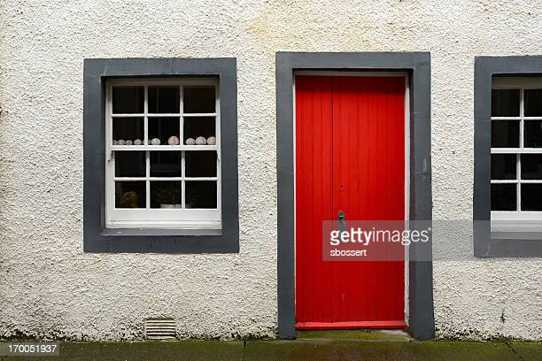 house with red door in east neuk of fife, scotland - east stock pictures, royalty-free photos & images