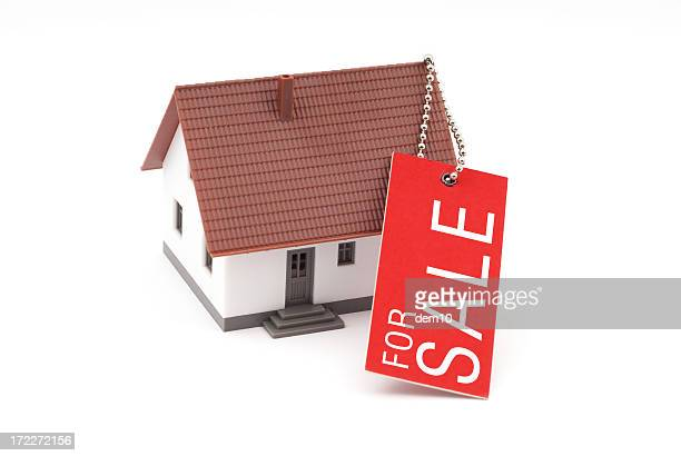 House With Sale Tag