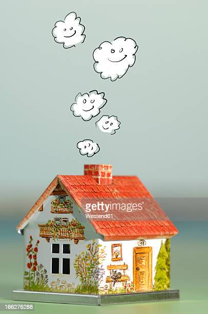 House with smoking chimney