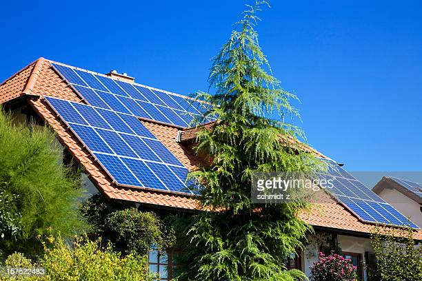house with solar panels - solar energy dish stock pictures, royalty-free photos & images