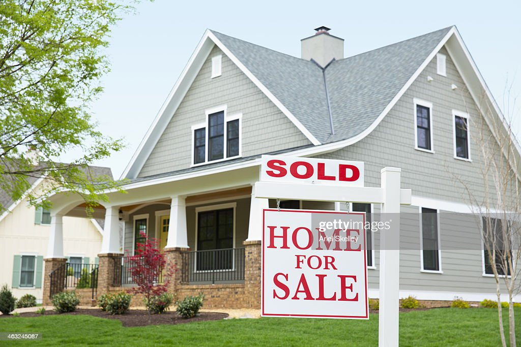 """House with """"""""sold"""""""" sign in front yard : Stock Photo"""