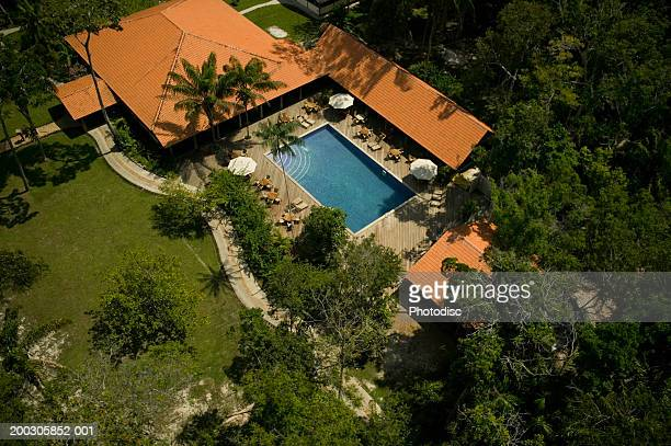 House with swimming pool in tropical location, aerial view