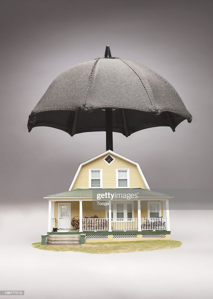 House with umbrella over it : Stock Photo