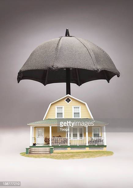House with umbrella over it