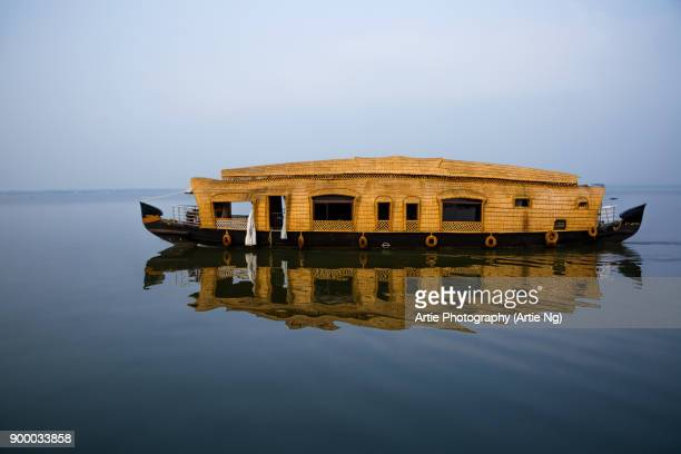 houseboat crusing by on vembanadu lake in the misty morning, kumarakom, kottayam, kerala backwaters, india - houseboat stock pictures, royalty-free photos & images