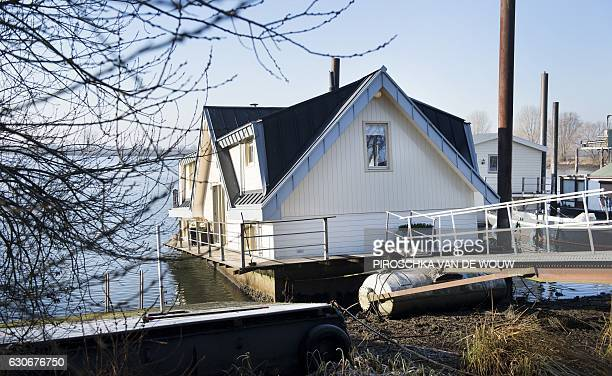 A houseboat is skewed by the low water levels in the Maas river near Germany at Gennep The Netherlands on December 30 2016 The weir at the Thompson...