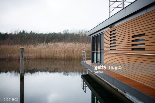 houseboat on a lake, saxony-anhalt, germany - houseboat stock pictures, royalty-free photos & images