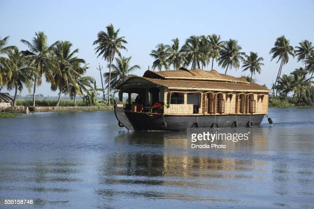 Houseboat on river in Alappuzha, Kerala, India.