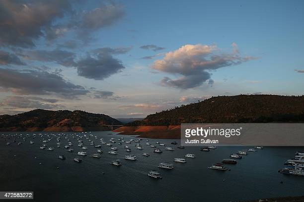 Houseboats in the Bidwell Canyon Marina are dwarfed by the steep banks of Lake Oroville on May 7 2015 in Oroville California As California enters its...