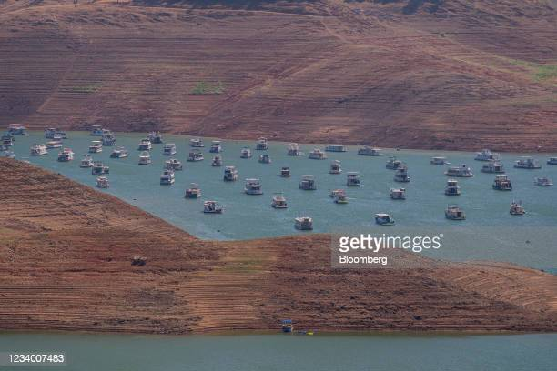 Houseboats on Lake Oroville during a drought in Oroville, California, U.S., on Thursday, July 15, 2021. Water levels at Lake Oroville could drop so...