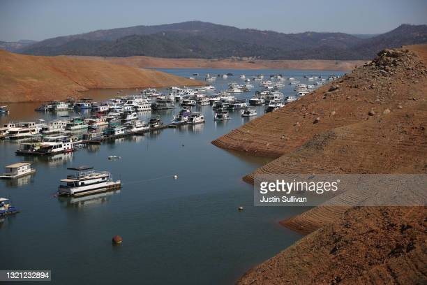 Houseboats sit anchored at the Bidwell Canyon Marina on Lake Oroville on June 01, 2021 in Oroville, California. As water levels continue to fall at...