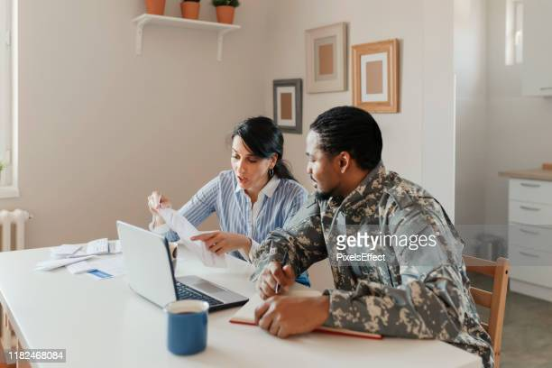 household accounting - veteran stock pictures, royalty-free photos & images