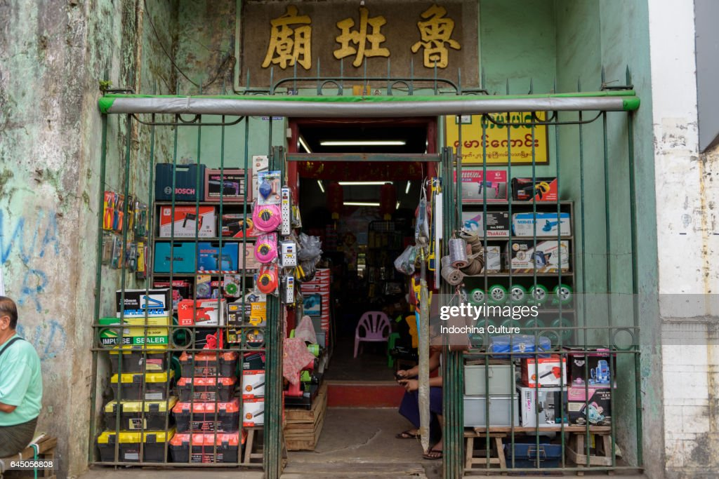 Household And Electronic Mobile Shop On The Street At Yangon