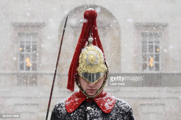 Household Cavalry Guard stands in the blizzard as heavy snow hits Westminster on February 28 2018 in London United KingdomFreezing weather conditions...