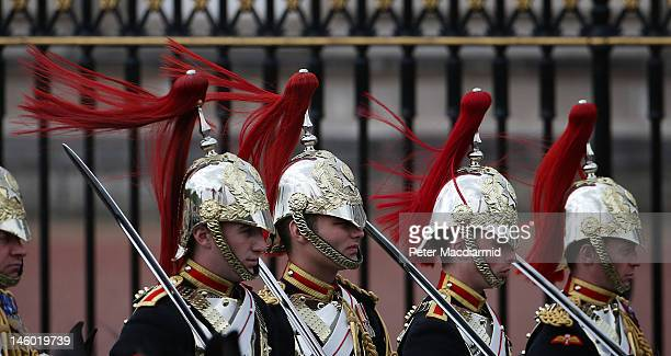 Household Cavalry soldiers' plumes blow in the wind during the Colonel's Review in The Mall on June 9, 2012 in London, England. The Colonel's Review...