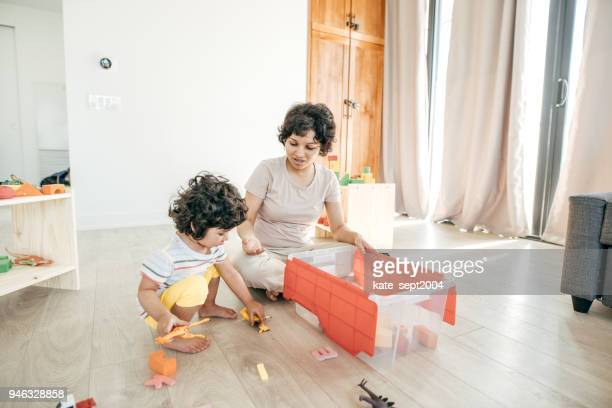 household chores for a toddler - toy box stock pictures, royalty-free photos & images