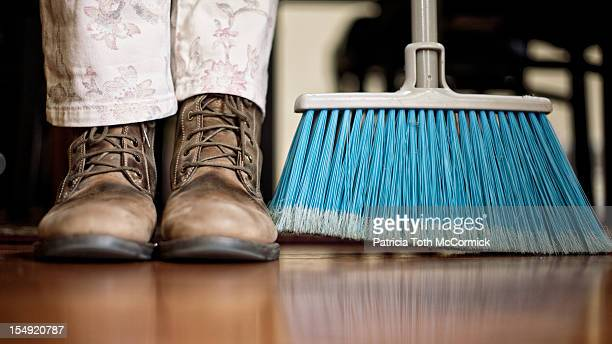 Household Chores in Workboots with Broom