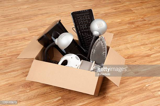 household equipment or appliances in a cardboard box - obsolete stock pictures, royalty-free photos & images