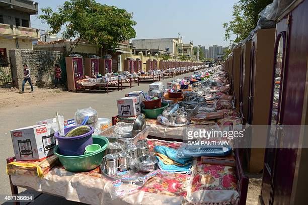 Household items are laid out before being given free of cost to Muslim couples participating in a mass wedding ceremony at the ancient Sarkhej Roza...