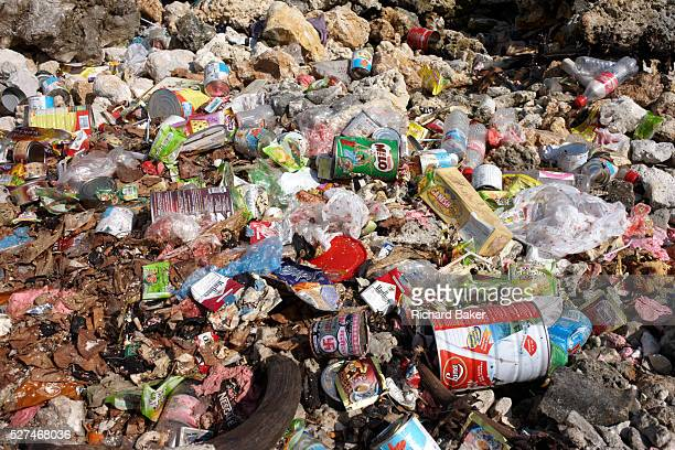 Household refuse pollutes a coral beach on Meedu Island an indigenous community in the Republic of the Maldives in the Indian Ocean Packaging...