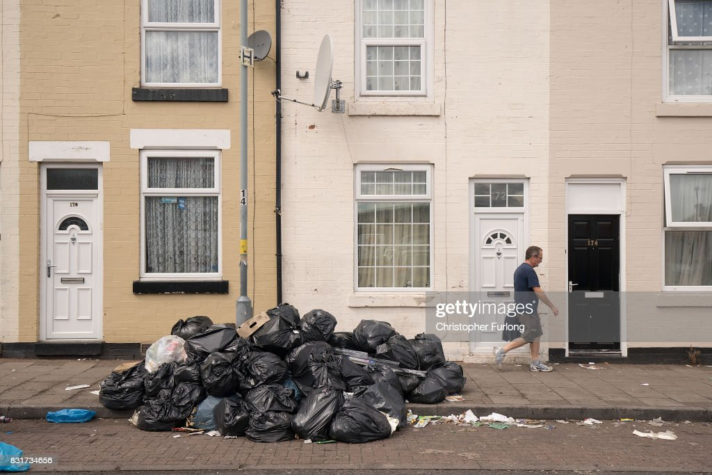 Household rubbish begins to pile high on the streets of Alum Rock in Birmingham as the refuse collector strike enters its sixth week on August 15, 2017 in Birmingham, England. Rubbish collectors in Birmingham have been taking industrial action over a dispute with Birmingham council over job losses.