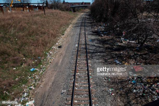 Household trash and empty needle wrapper paper is seen next to rail road tracks near a heroin encampment in the Kensington neighborhood of...