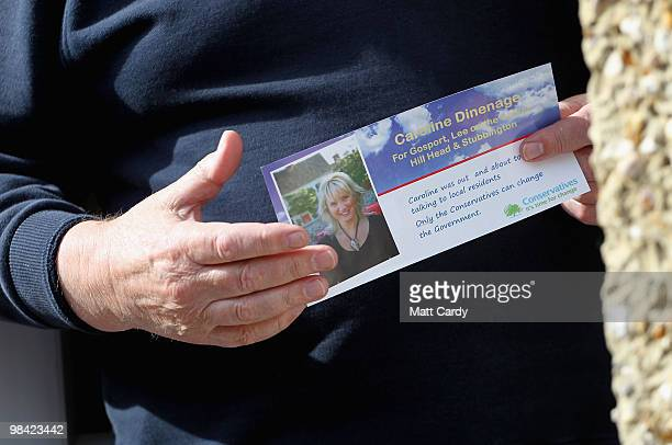 A householder holds a leaflet belonging to Conservative candidate Caroline Dinenage as she campaigns in the constituency of Gosport in Hampshire on...