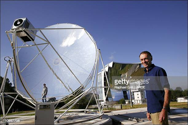 A householdsized solar power plant Dr Gilles Flaman and JeanMichel Gineste head of the 10Kw solar generator project A 8meter mirror parabola combined...
