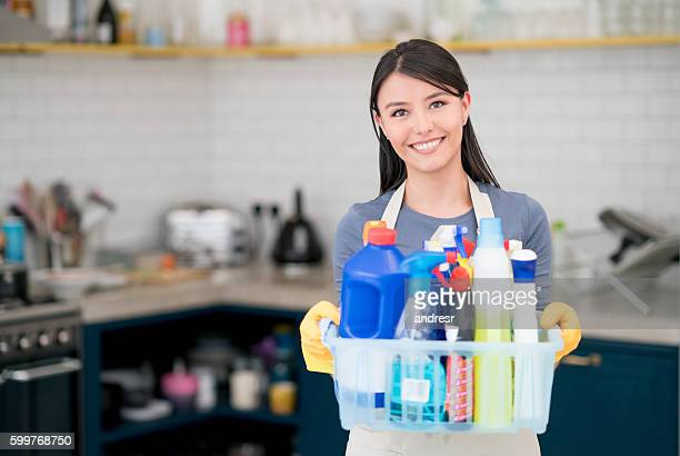 housekeeper holding cleaning products - clean stock pictures, royalty-free photos & images