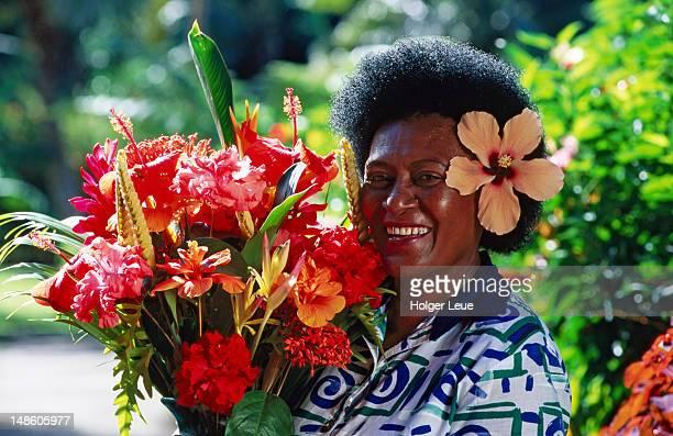 Housekeeper with flower arrangement, Jean-Michel Cousteau Resort, near Savusavu.