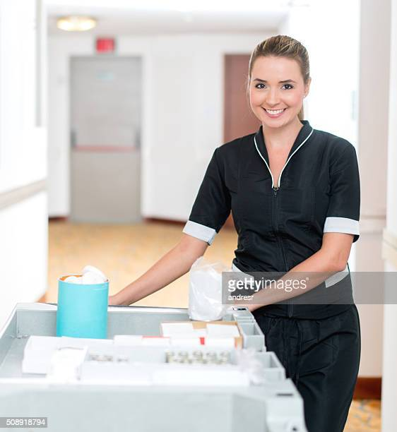 housekeeper working at a hotel - janitor stock photos and pictures